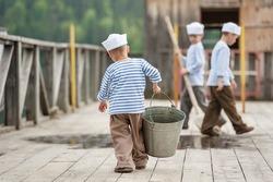 Three boy sailor washed mop berth