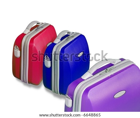 Three bright colored suitcase isolated on a white background with clipping path