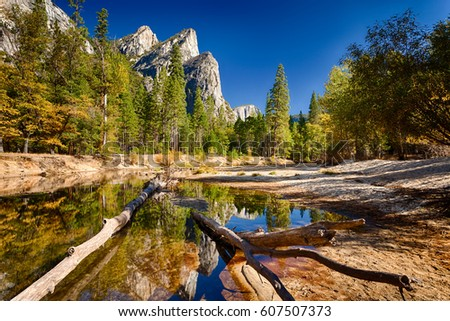 Three Brothers reflect on Merced River, Yosemite Valley, Yosemite NP,  California, USA