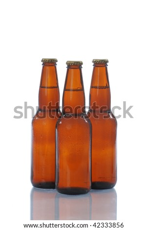 Three brown beer bottles on white background with a reflection.
