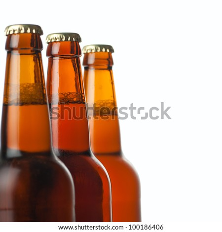 Three brown bottles of beer isolated on white background