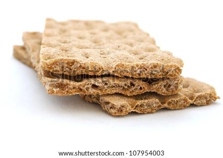 three brown cracker over white background, diet