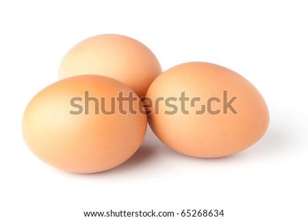 Three brown eggs on white background