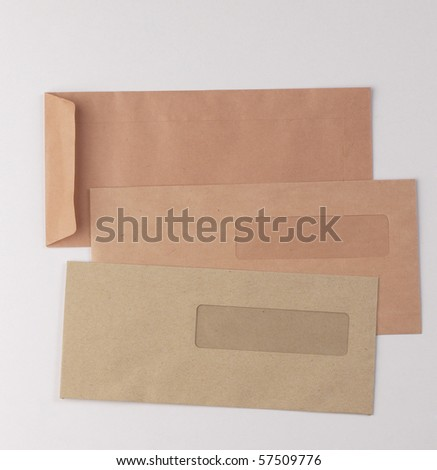 Three brown envelopes, isolated on plain background with rear and front view. - stock photo