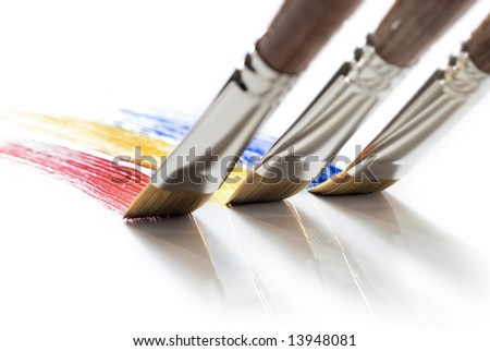 three brushes painting colors