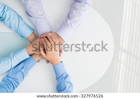 Three business colleagues showing their team spirit