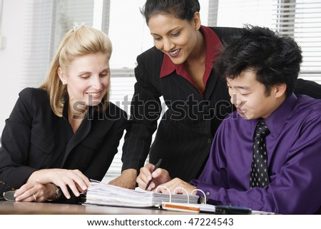 Three business executives in a discussion. - stock photo