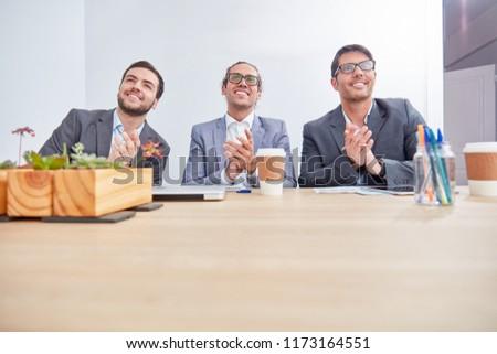 Three business men applaud in a seminar or seminar #1173164551