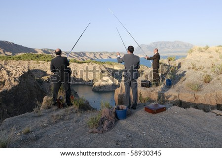 Three business men fishing
