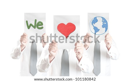 "Three business men showing paper with ""We love Earth"" symbol for eco concept"
