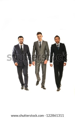 Three business men walking isolated on white background