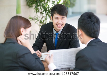 Three business partners being glad about the latest news