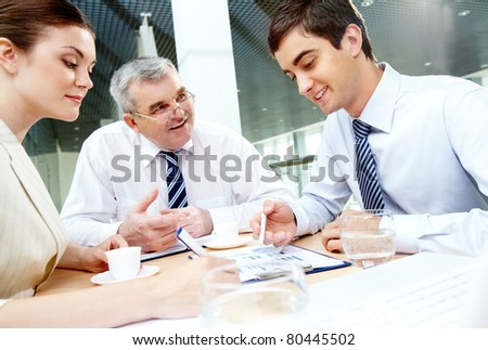 Three business partners sitting in office and planning work