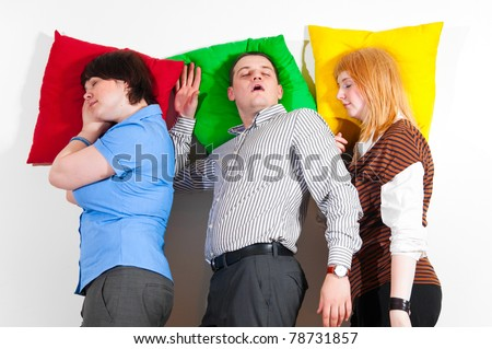 three business people are sleeping together at office