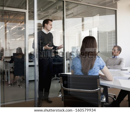 Three business people discussing during business meeting