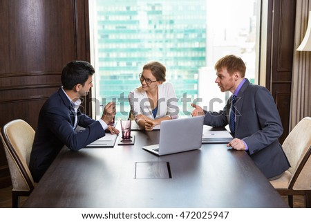 Three Business People Discussing Issues