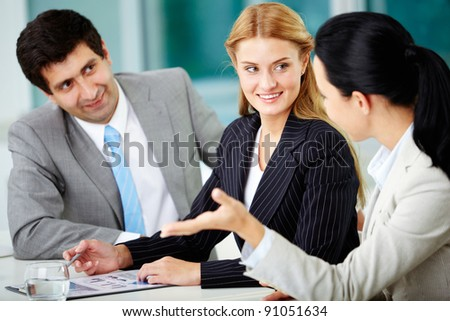 Three business people discussing new project in office