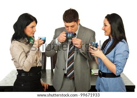 Three business people having coffee break in their office