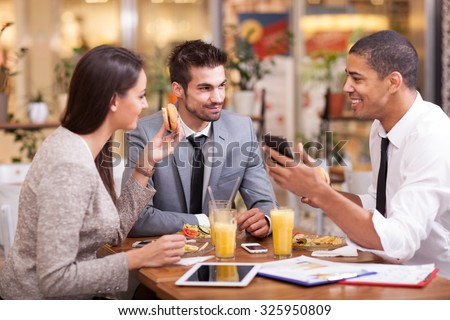 Three Business people Having Meeting In Outdoor Restaurant