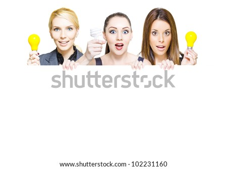 Three business people holding up light bulbs and blank copy space sign in a advertisement for a innovative idea, insight and business success, isolated on white - stock photo