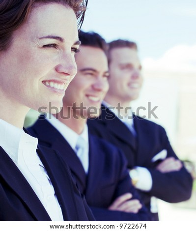 three business people standing in a row looking in same direction