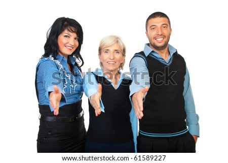 Three business people standing with their hands straight for handshake and smiling isolated on white background