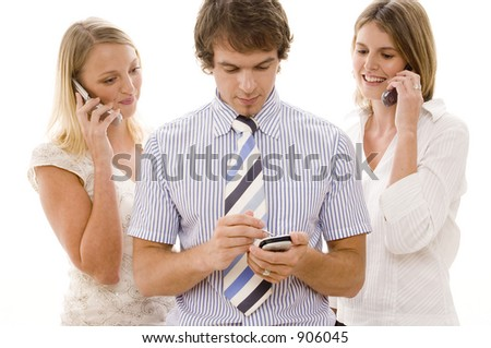 Three business people using technology for communication