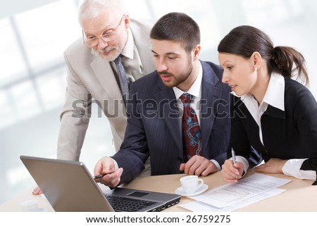 Three business people working in team