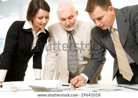 Three business people working together