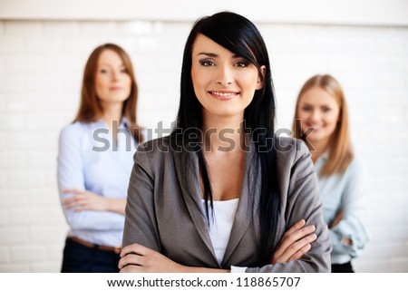 Three business women smiling. Selective focus