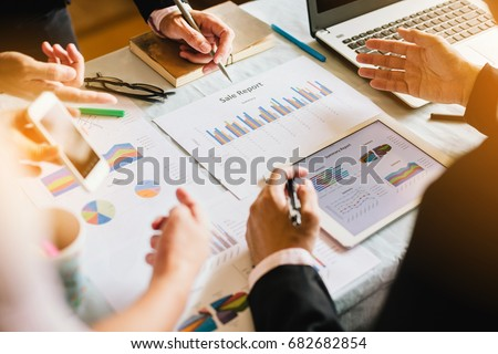 Three businessman investment consultant analyzing company financial report balance sheet statement working with documents graphs. Concept picture for stock market, office, tax,and project.