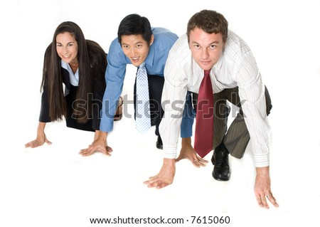 Three businessmen and women crouched down ready to start a race