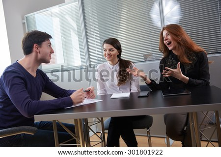Three businessmen discussing something together #301801922