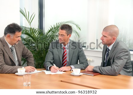 Three businessmen during a meeting