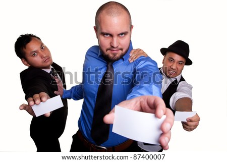 Three businessmen fighting to give their presentation card - stock photo