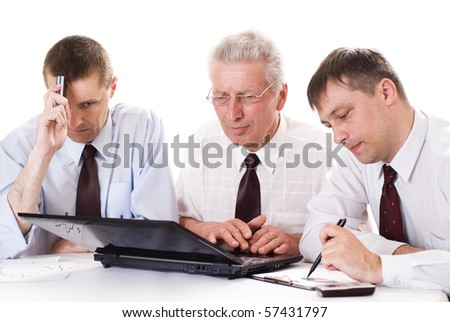 Three businessmen working at a table on a white