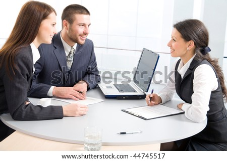 Three businesspeople discussing - stock photo