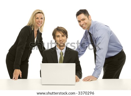 Three businesspeople share a laptop