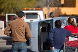 Three bystanders at vehicle crash scene