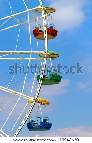 Three cabins Ferris wheel on a background of sky