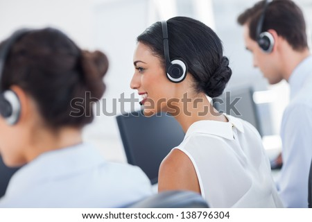 Three call centre employees working in line
