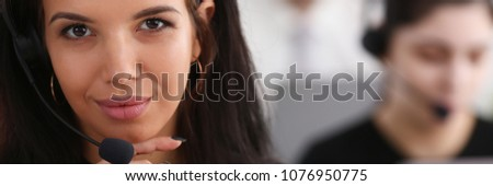 Three call centre service operators at work. Portrait of smiling pretty brunette woman at workplace employment effective mediation negotiation participation solve problem real time aid job concept #1076950775