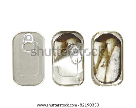 Three can of preserved sardines packed with virgin olive oil, in different stage of being pry open, isolated against white.