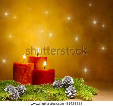 Three candles decorated in a festive Christmas decoration, with space for advertising text