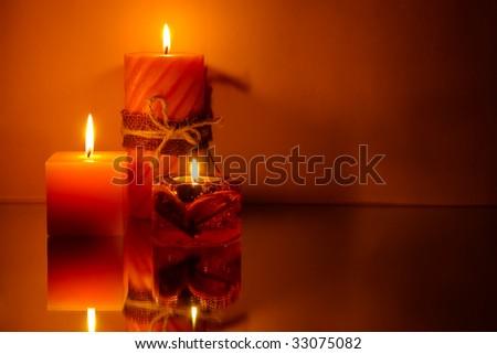 Three candles on orange background