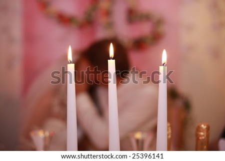 stock photo Three candles on wedding table just married in background