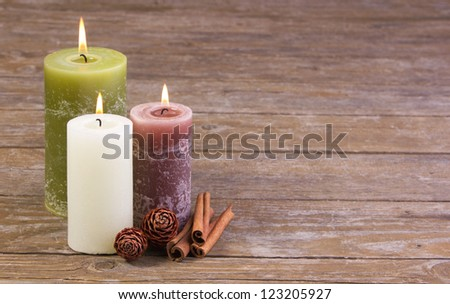 three candles on wooden ground/candles/christmas