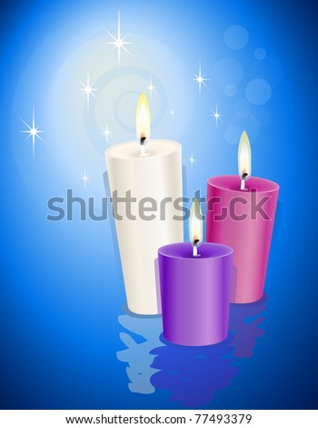 Three candles over a blue background - stock photo