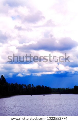 Three canoes, approaching storm, Boundary Waters Canoe Area Wilderness, Minnesota, USA