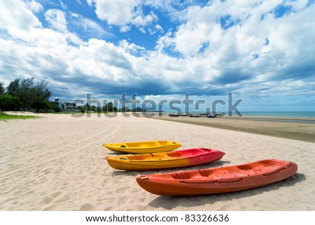 three canoes on the beach with beautiful sky, Thailand